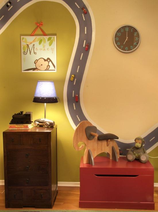Måla med magnetfärg (finns hos din färghandlare)  och fäst magneter med lim under barnets bilar.